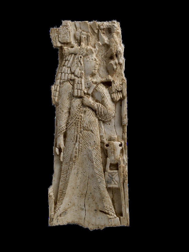 Ivory plaque carved with woman or goddess wearing vulture-capped wig in Egyptian style, inscription (AN1962.603)