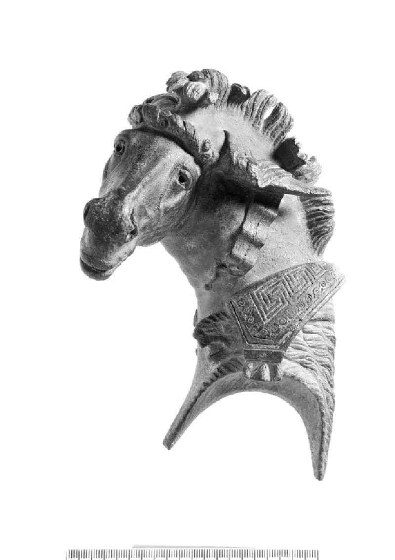 Head of a mule from a bronze fulcrum (ornamental couch-end) inlaid with silver with Greek inscription (AN1976.572)