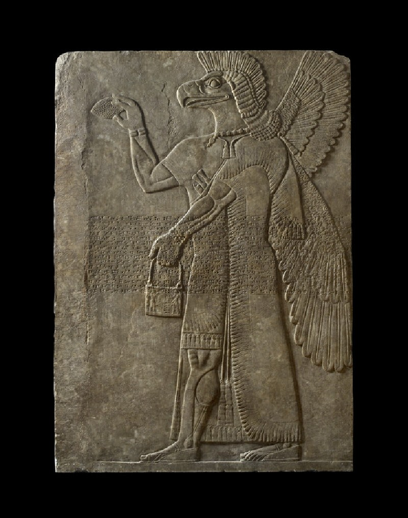 Relief of winged genius with cuneiform inscription of Ashur-nasir-pal II (AN1982.224)