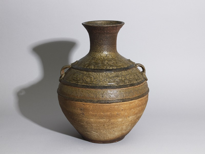 Greenware wine vessel, or hu, with serpent-like decoration