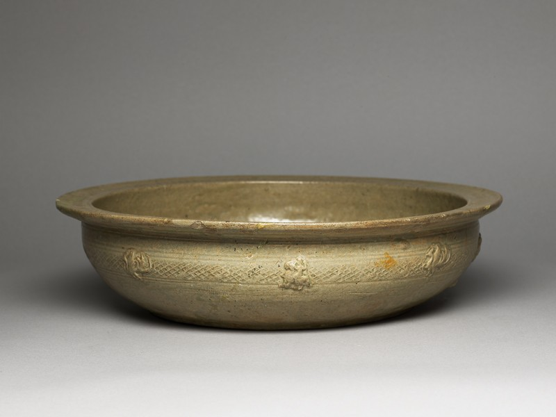 Greenware basin with fish, phoenix, and riding figures