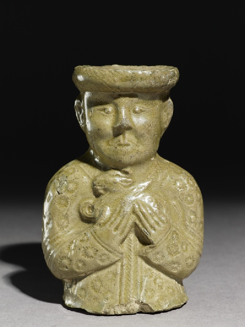 Greenware burial vessel section in the form of man holding a goat