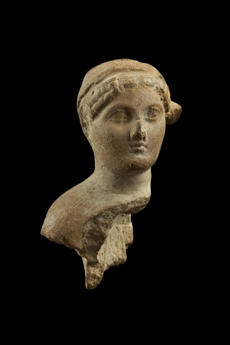 Fragmentary bust of a female figure (EA1958.16)