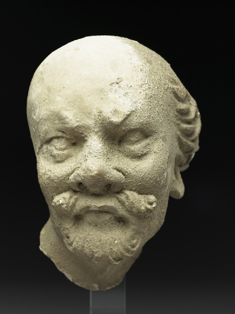 Stucco head of a man (EA1958.2, front          )