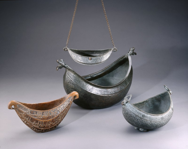 Kashkul, or begging bowl, in the form of a boat (EA1959.12, oblique with EA1959.10, EA1978.153 and EA1992.31           )