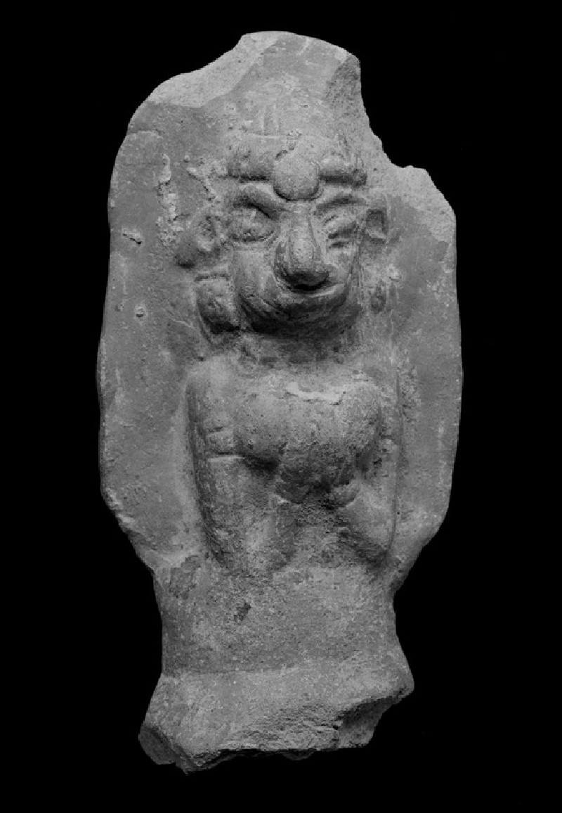 Plaque with a female figure with folded hands (EA1967.76)