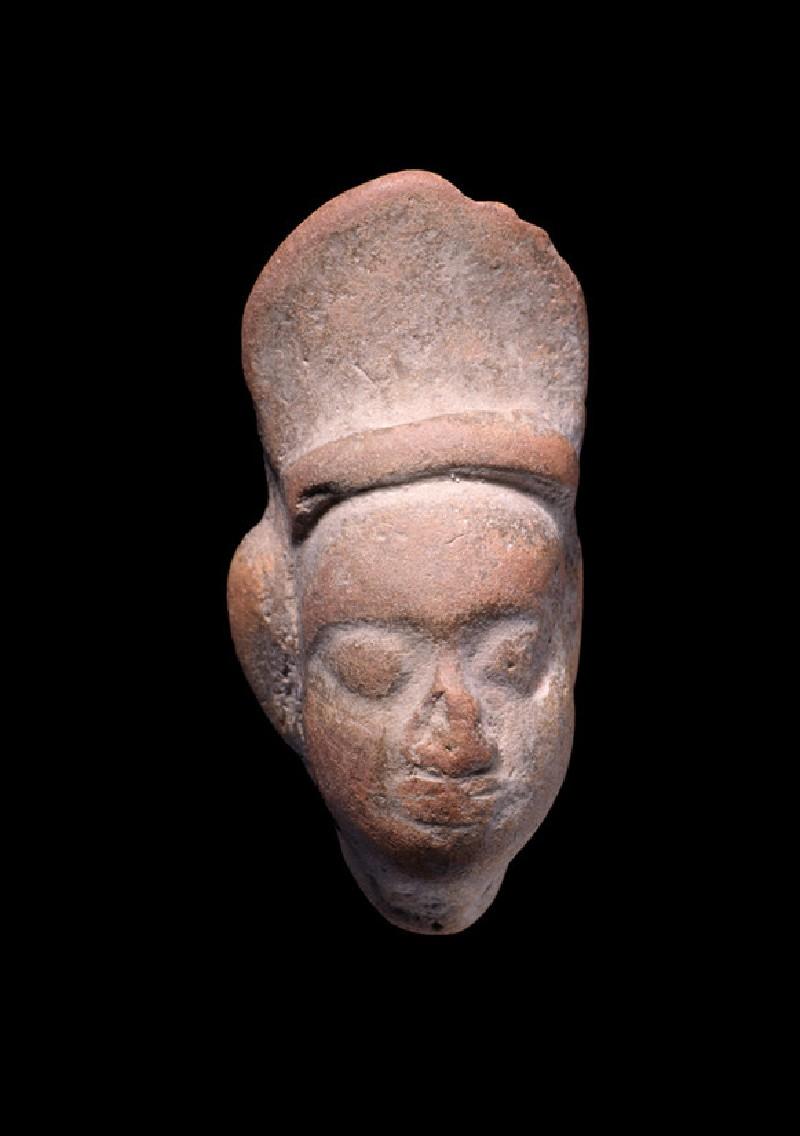 Head of a figure wearing a cap or helmet, possibly male