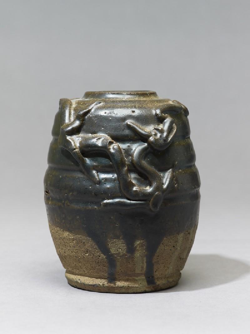 Dark brown glazed dragon jar