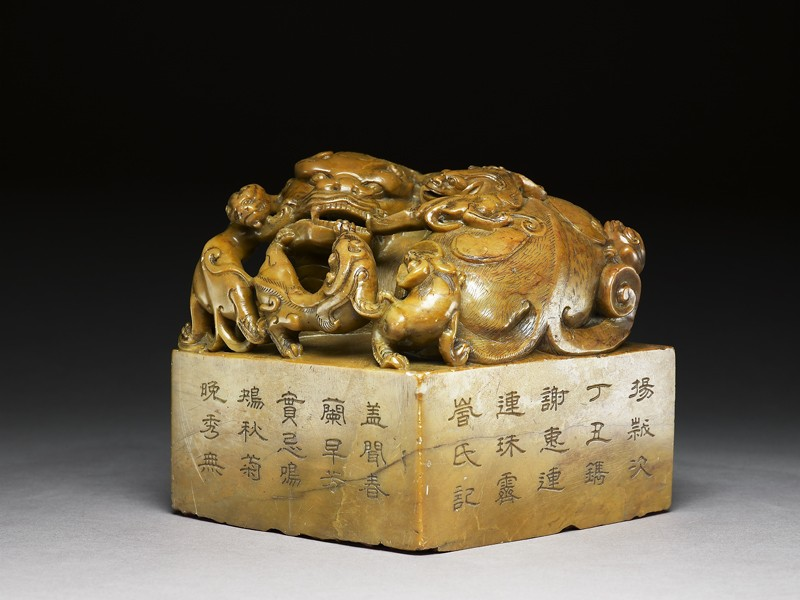 Soapstone seal surmounted by shishi, or lion dog, and seven pups