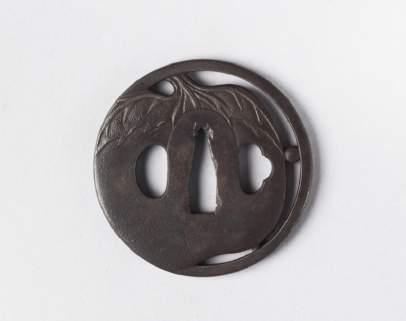 Round tsuba with design of a vegetable, possibly an aubergine (EA1978.398, front            )