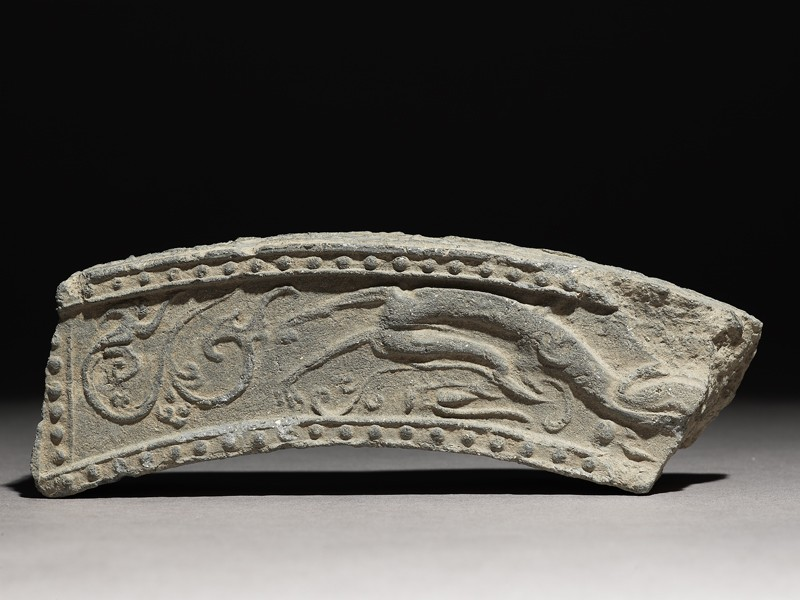 Fragment of a roof-tile with running dragon (EA1983.232, front            )