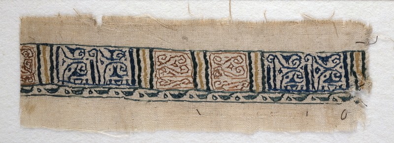 Textile fragment with band of pseudo-inscription, leaf-shaped finials, and tendrils (EA1984.110, front            )