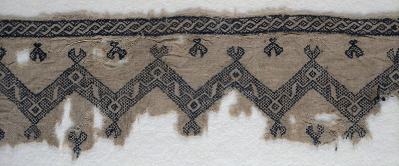 Textile fragment with chevrons and interlacing scrolls