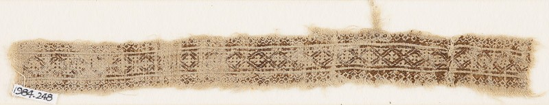 Textile fragment with linked diamond-shapes and quatrefoils (EA1984.248, front            )