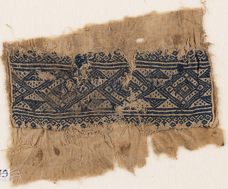 Textile fragment with linked diamond-shapes, triangles, and flowers (EA1984.349, front            )