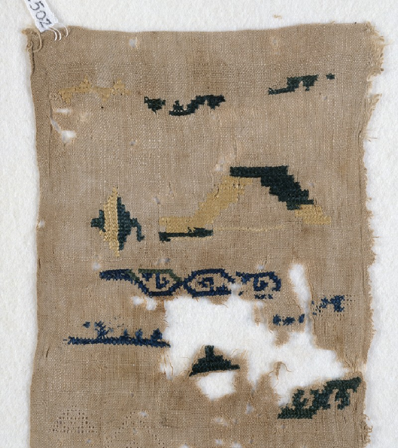 Sampler fragment with scrolls (EA1984.502, front            )