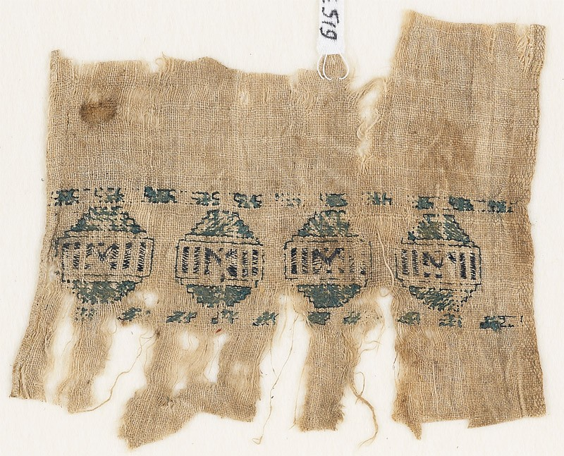 Textile fragment with diamond-shapes containing rectangles