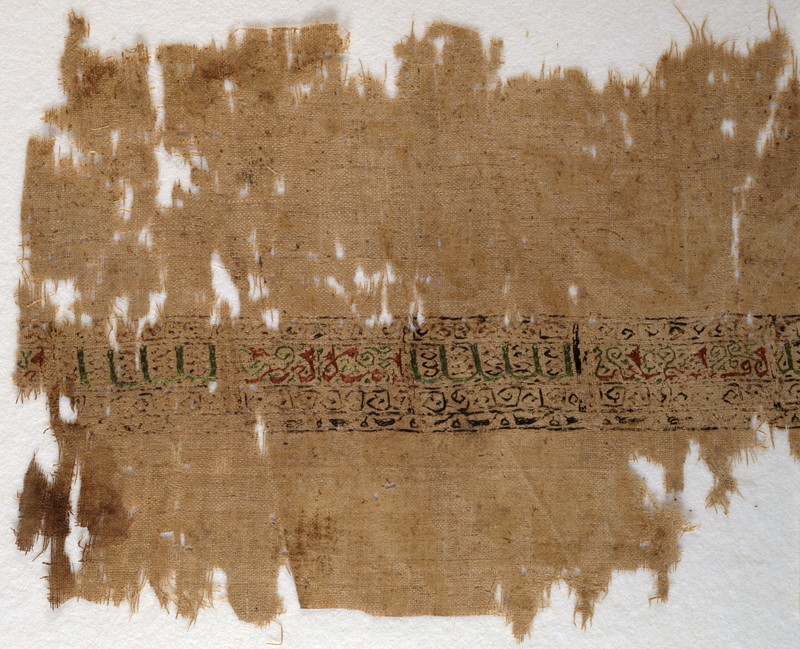 Textile fragment with band of pseudo-inscription, leaves, and vines