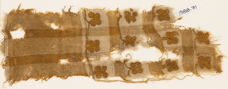Textile fragment with squares and flowers (EA1988.71, front           )