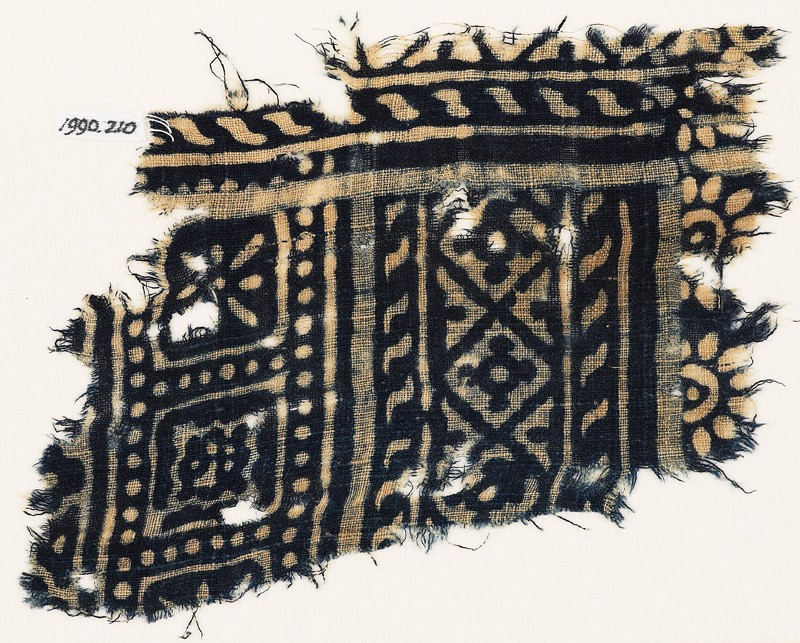 Textile fragment with diamond-shapes, and squares with rosettes