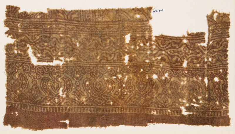 Textile fragment with stylized plants linked to form medallions (EA1990.375, front            )