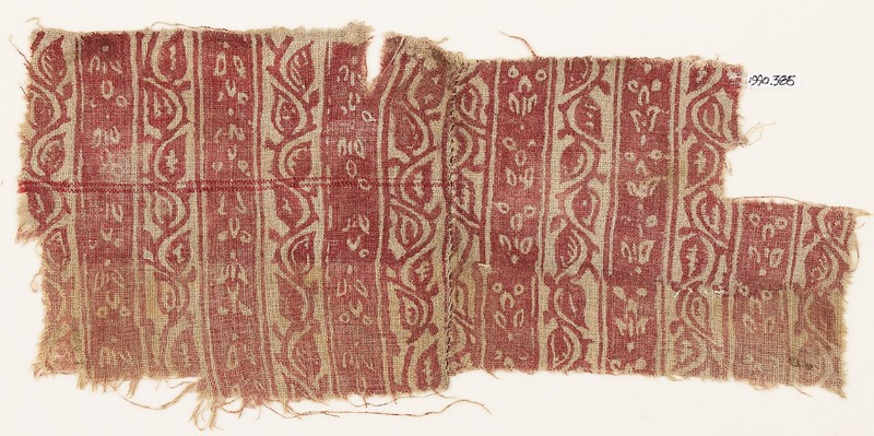 Textile fragment with bands of vine and flowers