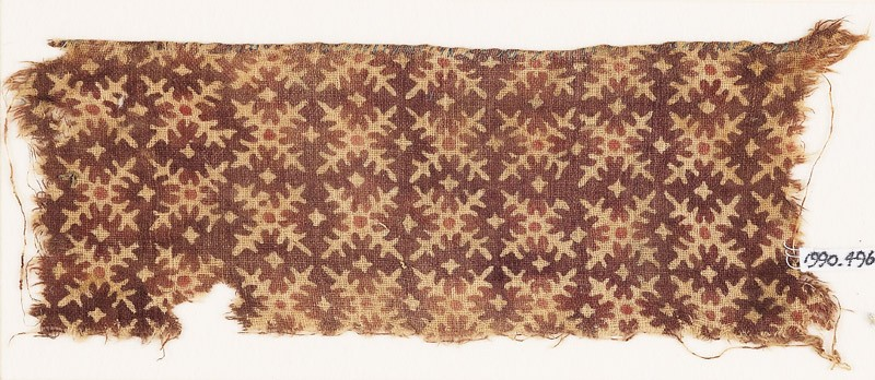 Textile fragment with serrated crosses