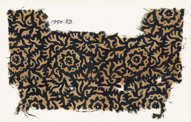 Textile fragment with swirling leaves and flowers (EA1990.52, front           )
