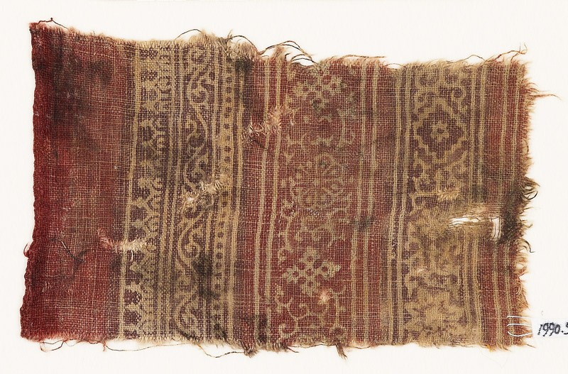 Textile fragment with vine, rosettes, tendrils, stars, and diamond-shapes