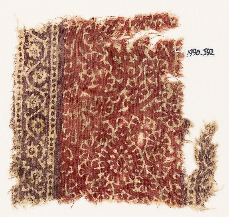 Textile fragment with scroll, flower-heads, and rosettes (EA1990.592, front            )