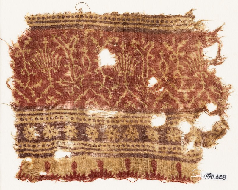 Textile fragment with stylized plants, half-medallions, rosettes, and crenellations (EA1990.608, front            )