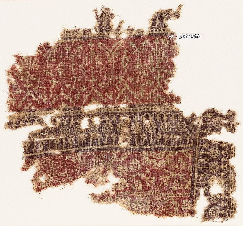 Textile fragment with plants, half-medallions, and dotted circles (EA1990.625, front            )