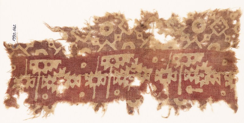 Textile fragment with serrated shapes, rosettes, and squares (EA1990.662, front            )