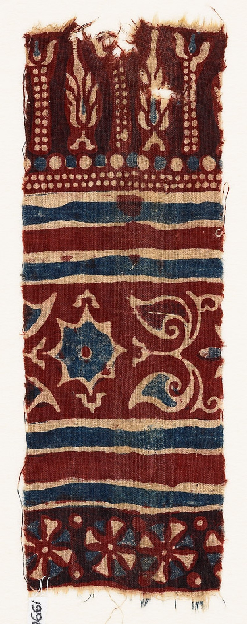 Textile fragment with stylized trees, a star, and leaves (EA1990.934, front            )
