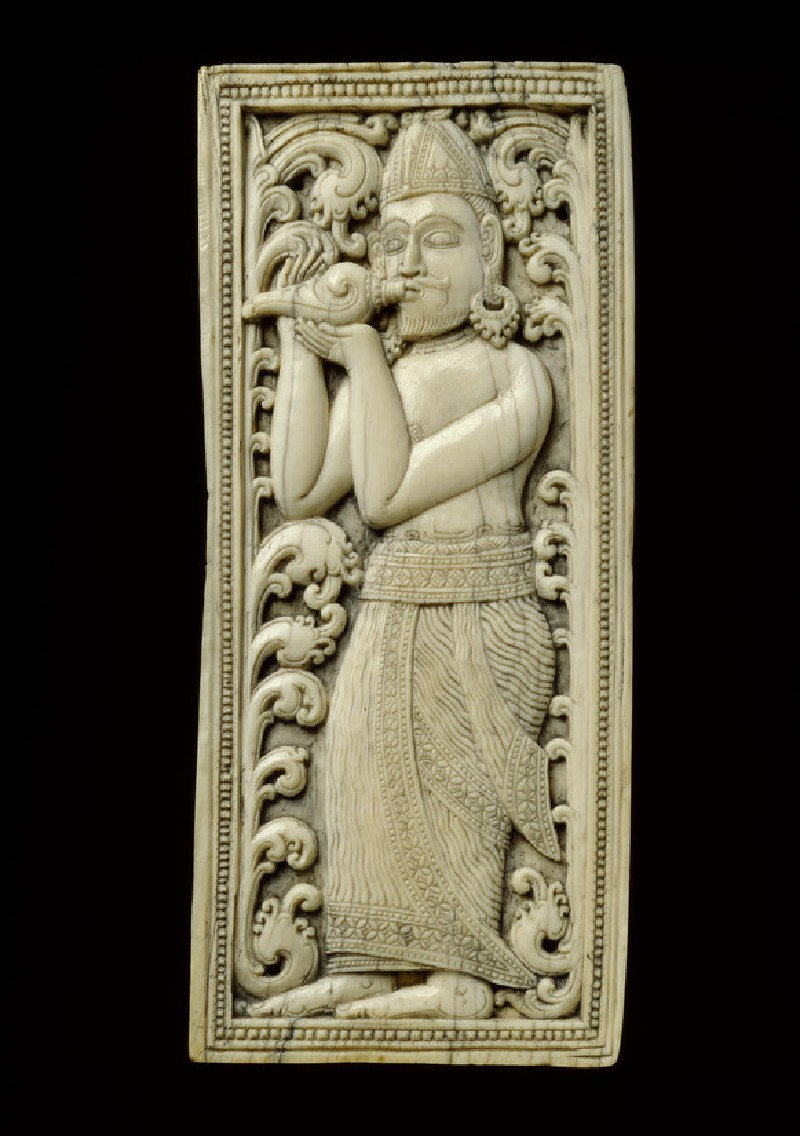 Ivory plaque with conch-blower (EA1990.1291)