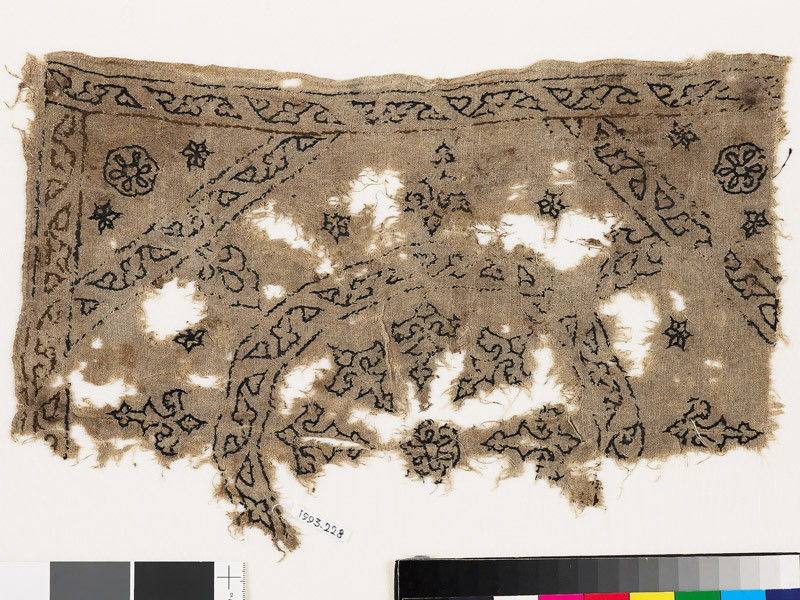 Textile fragment with remains of a roundel, octagon, square, and plant shapes (EA1993.228, front            )