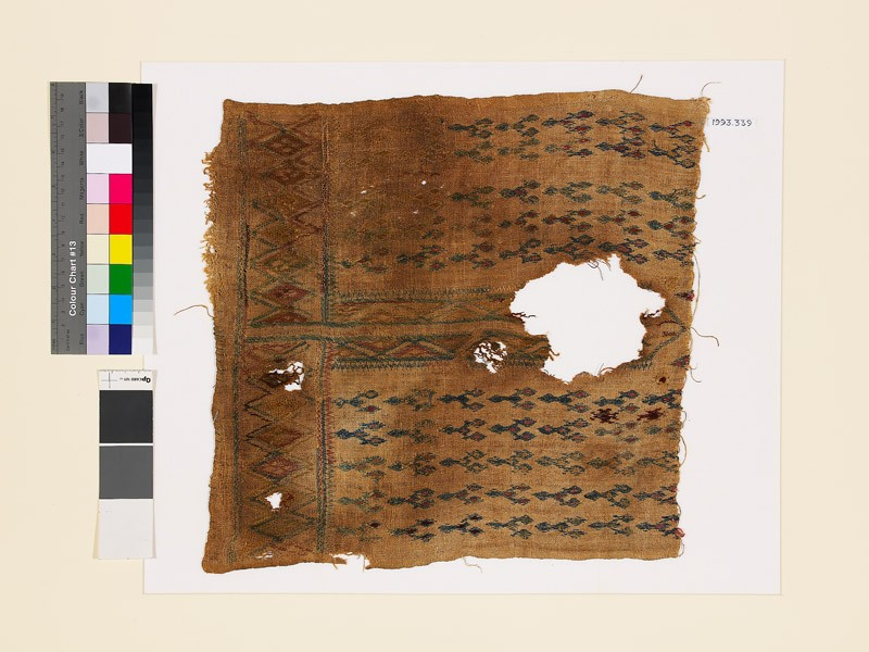 Textile fragment with linked diamond-shapes, possibly from the front of a garment (EA1993.339, front            )