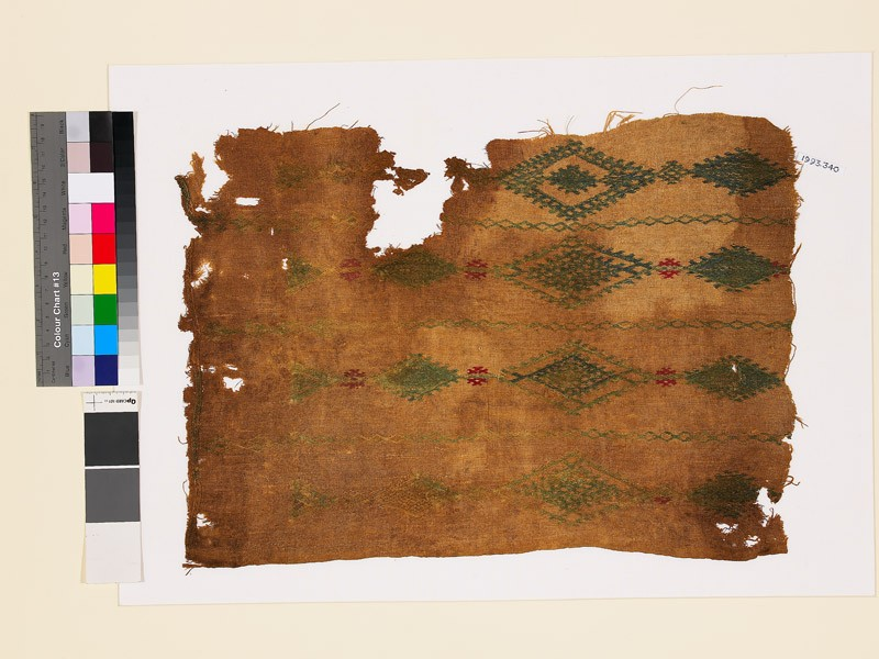 Textile fragment with linked diamond-shaped medallions and lattice (EA1993.340, front            )