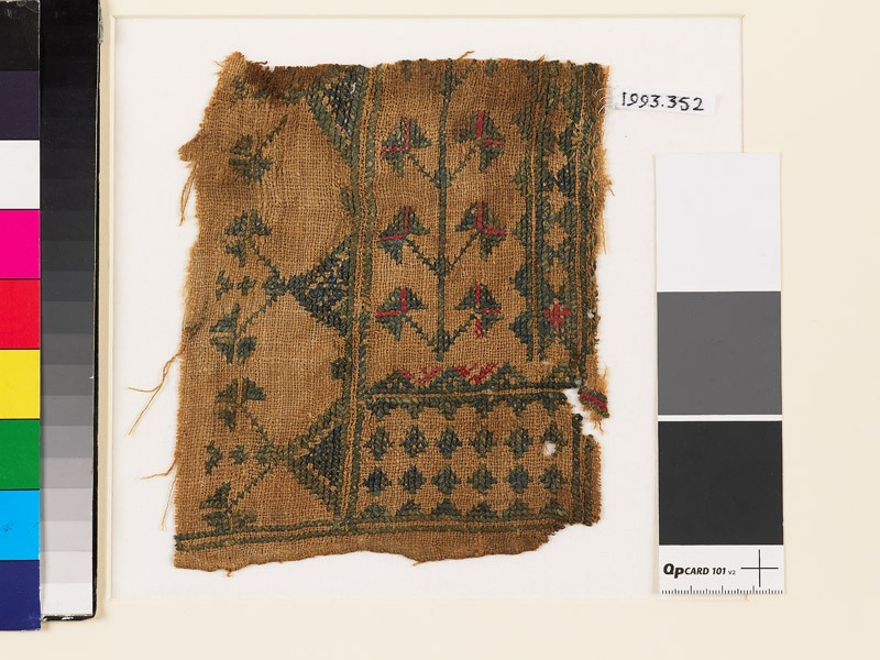 Textile fragment with stylized flowers, diamond-shapes, and triangles (EA1993.352, front            )