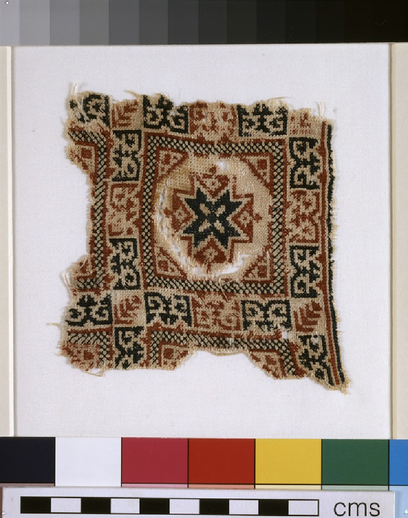 Textile fragment with star and pseudo-inscription (EA1993.357)
