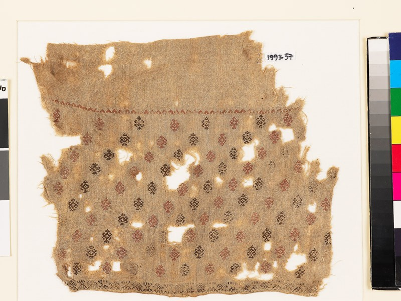 Textile fragment with geometric shapes, probably from a tunic