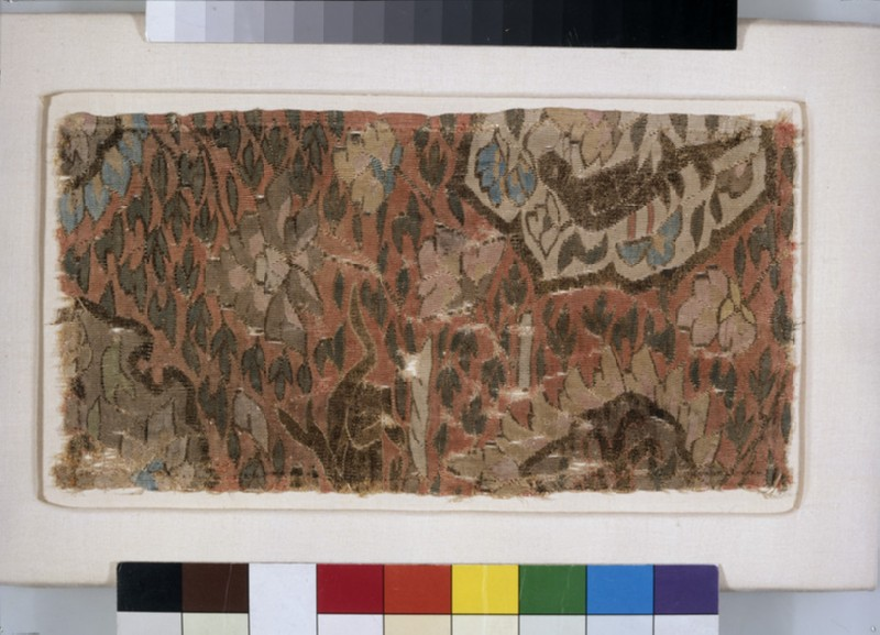 Tapestry fragment with bird, beast, and peonies