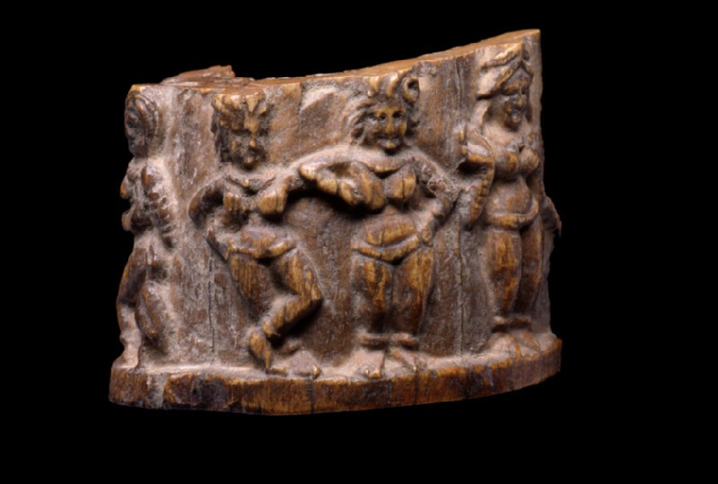 Cylindrical fragment carved with female figures in various poses