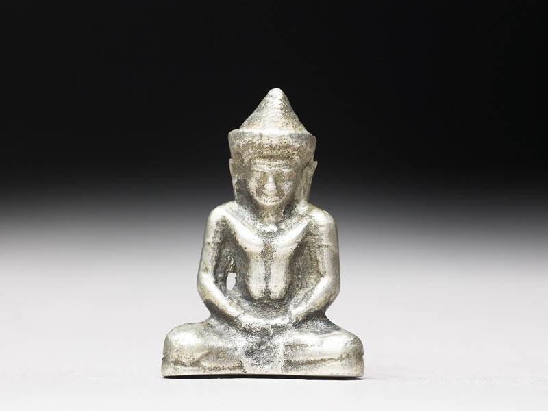 Silver amulet in the form of the Buddha