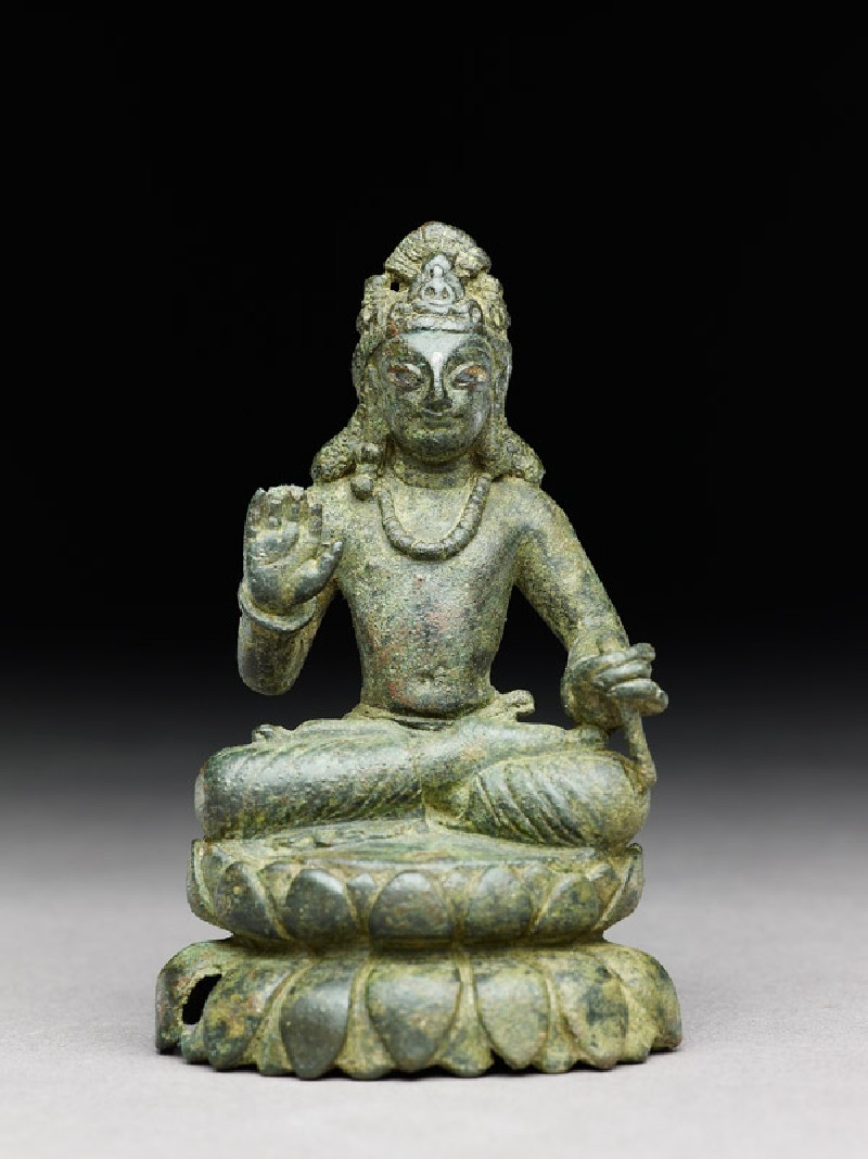 Figure of a seated bodhisattva or Maitreya, the future Buddha, on double lotus petal base