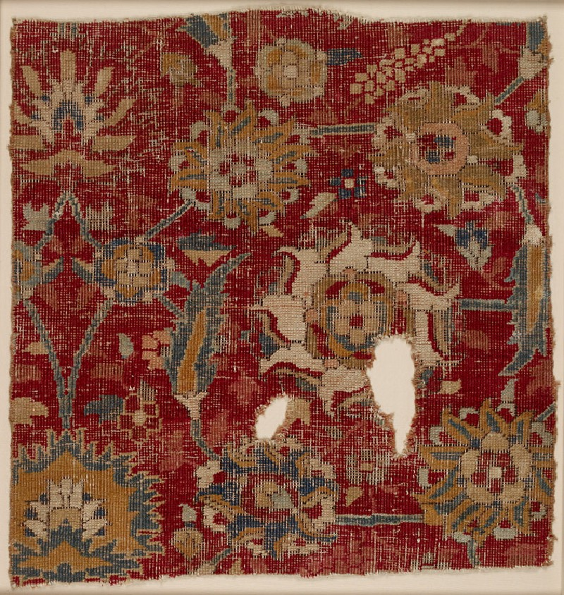 Mughal carpet fragment with scrolling vines and blossoms