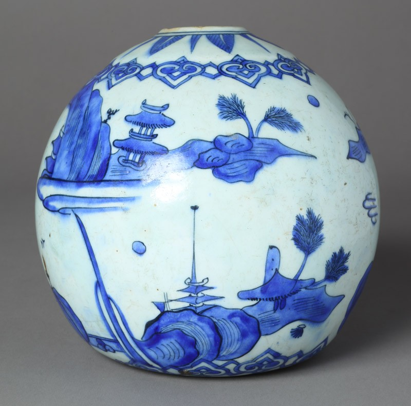 Base of a water pipe with animals in a landscape