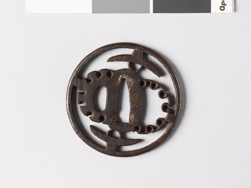 Round tsuba with hats and stylized snow heaps (EAX.10013, front           )