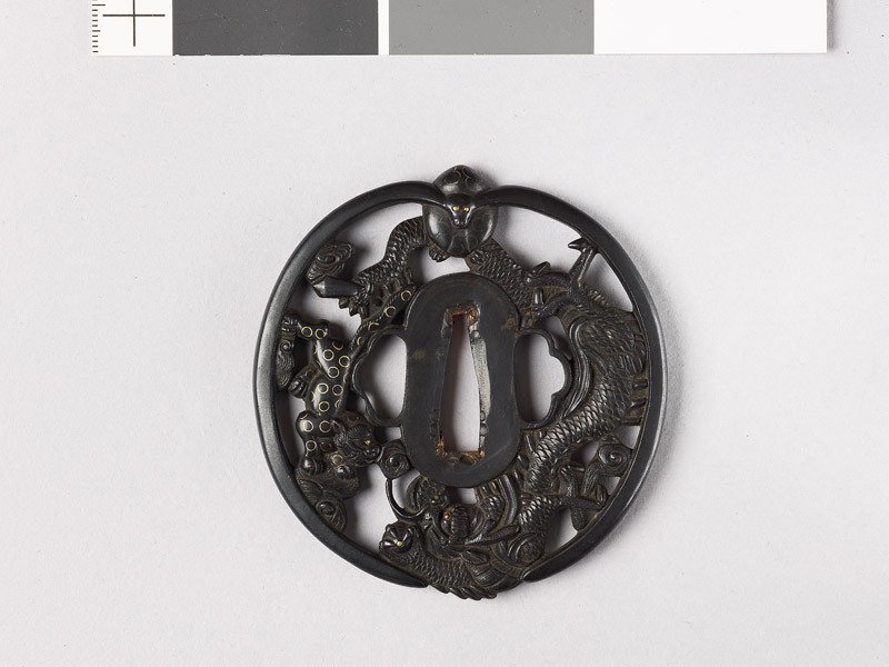 Tsuba with a hare, dragon, and tiger