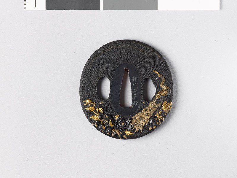Tsuba with peacock among peonies and rocks